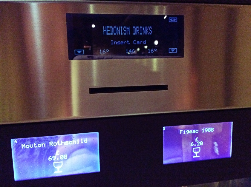 Enomatic machine with a card slot and wine information